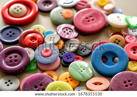 Many colorful garment buttons in various shapes and sizes Royalty-Free Stock Photo #1678355530