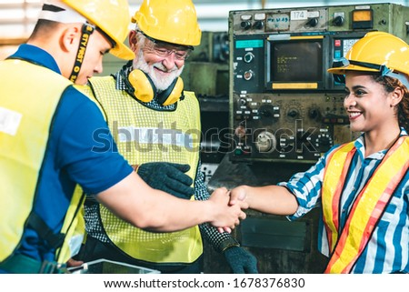 Industrial Engineers in Hard Hats.Work at the Heavy Industry Manufacturing Factory.industrial worker indoors in factory.aged man working in an industrial factory. #1678376830