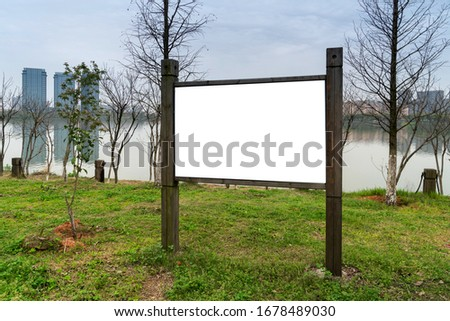 Blank sign board in the park
