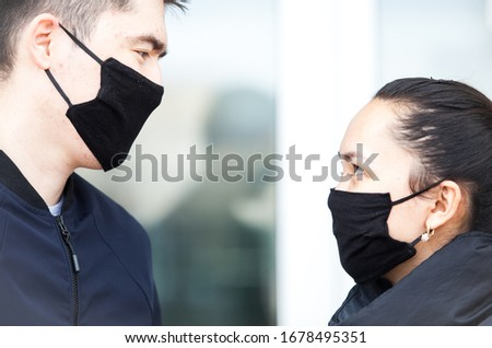 Almaty, Kazakhstan 20/03/2020:masked guy and girl look at each other  during corona virus #1678495351