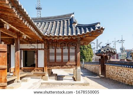 Traditional Korean style architecture at Hanok Village. Traditional Korean house. Traditional window of Hanok. Korean traditional window or Door. #1678550005