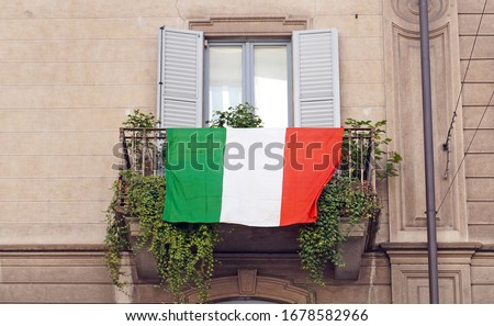Europe, Italy , Milan - Flag of Italy hanging on the balcony of a house during n-cov19 Coronavirus epidemic emergency                               #1678582966