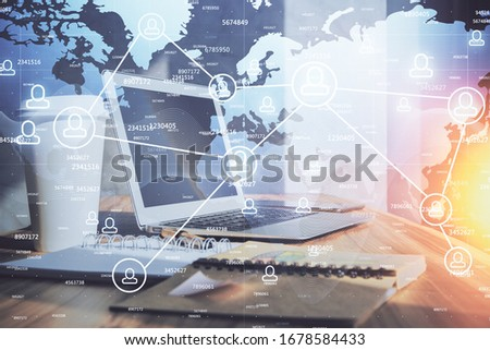Computer on desktop with social network hologram. Multi exposure. Concept of international people connections. #1678584433