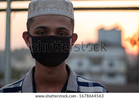 Iran muslim boy with hat going to jummah prayer,wearing face mask to prevent coronavirus.wearing mask can prevent the infection of coronavirus.Coronavirus and Air pollution pm2.5 concept in iran #1678664563