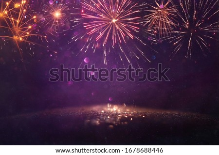 abstract gold, gold and purple glitter background with fireworks. christmas eve, 4th of july holiday concept #1678688446