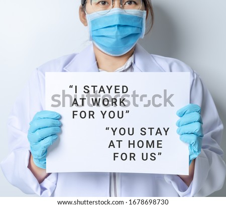 Doctor written with I stay at work for you, you stay at home for us. worried about covid-19 coronavirus. #1678698730