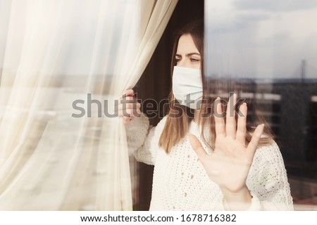 Young woman in medical mask stay isolation at home for self quarantine. Concept home quarantine, prevention COVID-19, Coronavirus outbreak situation #1678716382