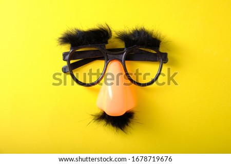 Overhead glasses, nose and mustache on April 1st, April Fool's Day Royalty-Free Stock Photo #1678719676