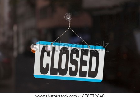 Close-up on a closed sign in the window of a shop. #1678779640