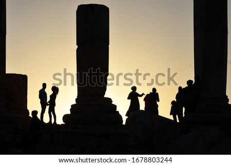 Amman, Jordan - February 15, 2020. Unidentified people at sunset in Amman Citadel, Jordan. The Amman Citadel is a historical site at the center of downtown Amman, the capital of Jordan #1678803244