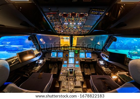 Empty Aeroplane Cockpit Interior Night Royalty-Free Stock Photo #1678822183