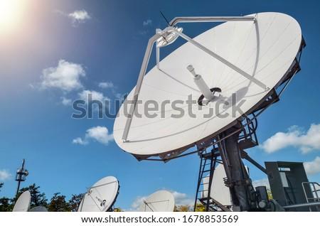 Many parabolic antennas against blue sky Royalty-Free Stock Photo #1678853569