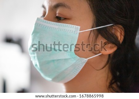 Portrait of women with Mask on for Coronavirus protection against blurred background #1678865998