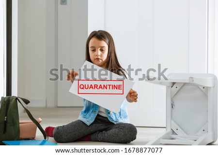 Quarantine and closed school during coronavirus outbreak. little girl on distance learning online. Homeschooling #1678877077