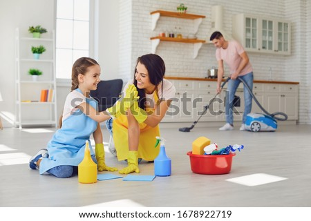 Happy family cleans the room in the house. #1678922719