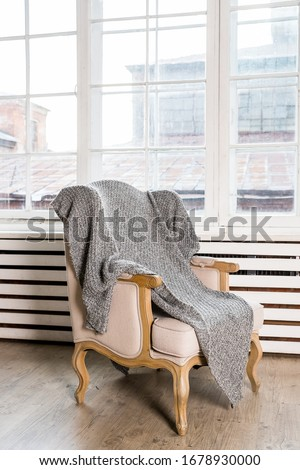 classic chair on wooden floor with grey blanket near big window.Reliable and comfortable room.country style chair .classic chair in vintage style bedroom interior.Stylish room interior #1678930000