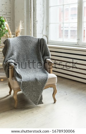classic chair on wooden floor with grey blanket near big window.Reliable and comfortable room.country style chair .classic chair in vintage style bedroom interior.Stylish room interior #1678930006
