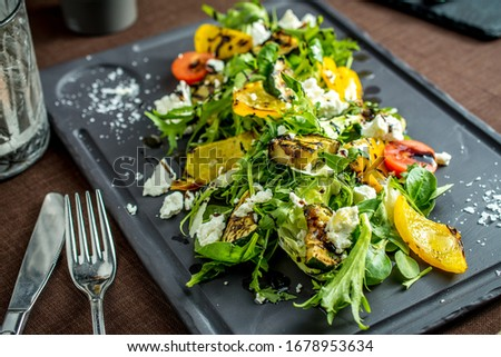 Grilled vegetables,salad, green lettuce and leaves, paprika, tomatoes and cucumbers with sauce #1678953634