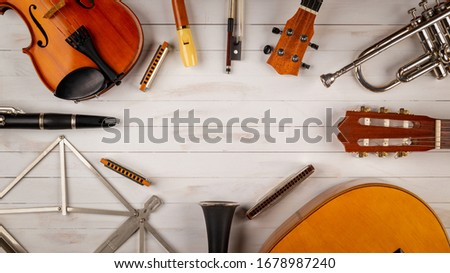instruments in white wooden background Royalty-Free Stock Photo #1678987240