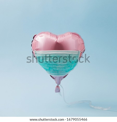 Pink balloon heart with face protective mask. COVID-19 concept. new Corona virus infection(novel coronavirus disease). Pandemic infectious background. Royalty-Free Stock Photo #1679055466