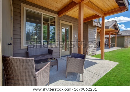 Amazing balcony patio with fire pit and forest and mountains view. Dream come true home exterior. New American architecture. Comfortable and beautiful home details. #1679062231