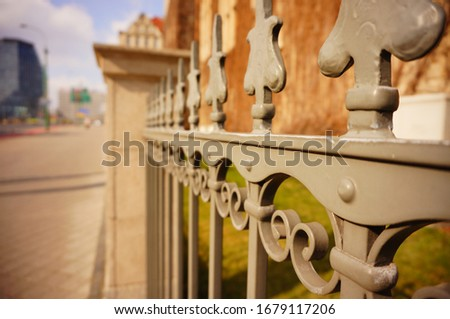 A closeup shot f a metal fence with blurred background #1679117206