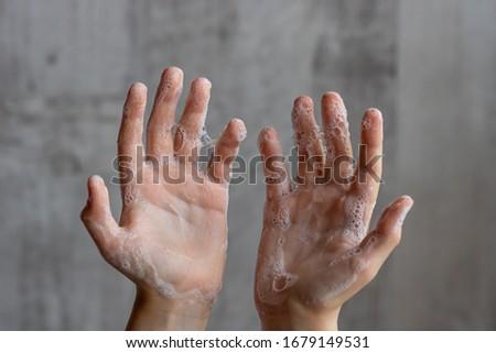 Children hands in soap suds. Hygiene.  Healthy lifestyle concept. #1679149531