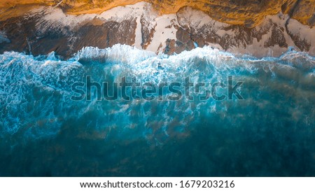 Drone photography. We see how the sea collides with the stones and sand of a beach in México. Royalty-Free Stock Photo #1679203216