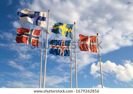 Scandinavian flags towards blue sky