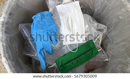 Used infectious masks and medical glove in the trash bin,infectious waste, prevented virus covid-19 by separating infected waste. Royalty-Free Stock Photo #1679305009