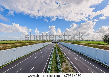 No traffic on this empty deserted modern deepened highway A4, The Hague - Rotterdam, Netherlands. This modern highway is built in a deepened location to save the Midden-Delfland nature reserve. #1679316280