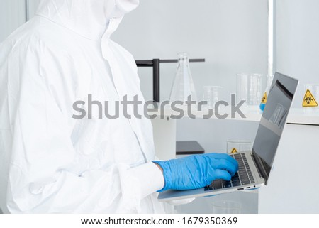 Researchers in the laboratories are using laptop to research and gather useful information to combat the viruses and pestilences that people around the world are facing. #1679350369