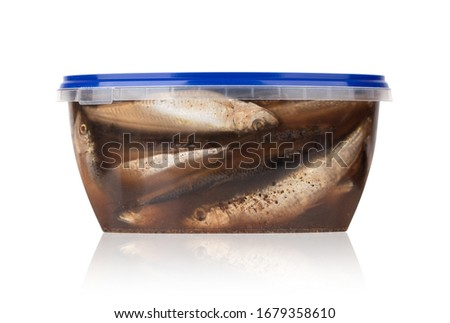 Sprat marinated in a jar. Pickled sprat in a plastic container on a white background. #1679358610