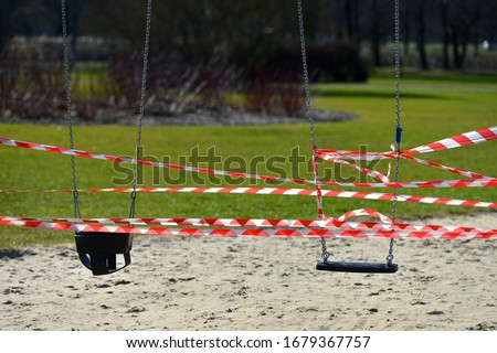 Closed children's playground. COVID-19 security and protection measures in the city park. Royalty-Free Stock Photo #1679367757