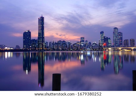 Night view of Han River after sunset with the background of 63 Building and high-rise buildings at Yeouido, Seoul, Korea #1679380252