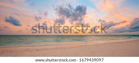 Sea sand sky concept, sunset colors clouds, horizon, horizontal background banner. Inspirational nature landscape, beautiful colors, wonderful scenery of tropical beach. Beach sunset, summer vacation #1679439097