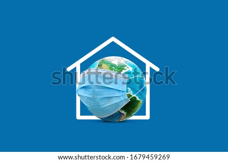 Creative corona (Covid-19) post concept realistic world wears mask  protect from viruses around the world. Effective and meaningful design for corona virus it say ''Stay Safe''  Royalty-Free Stock Photo #1679459269