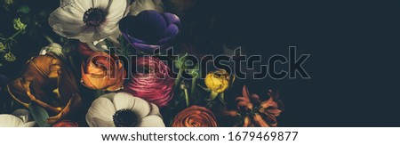 Vintage bouquet of beautiful different flowers. Floristic decoration. Floral background. Baroque old fashiones style image. Natural pattern wallpaper or greeting card Royalty-Free Stock Photo #1679469877