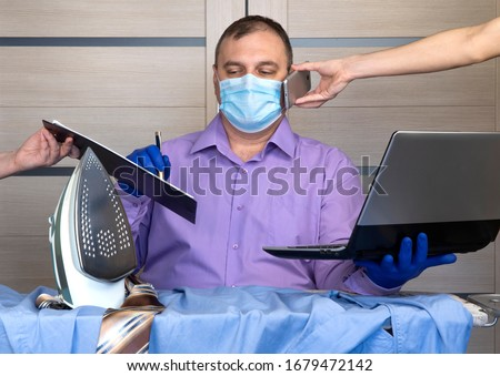 quarantine coronavirus pandemic. business man working from home, wear a protective mask. antiviral medical respiratory bandage face. remote distance work due to the epidemic COVID-19. home office Royalty-Free Stock Photo #1679472142