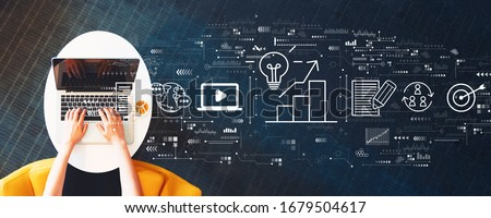 Content marketing concept with person using a laptop on a white table Royalty-Free Stock Photo #1679504617