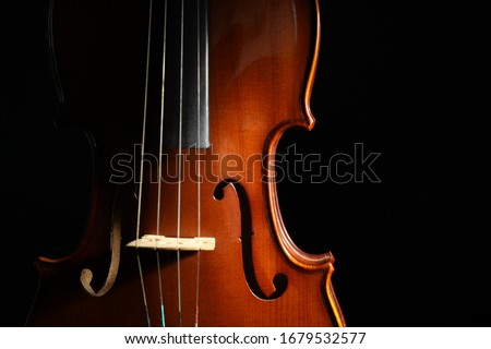 Classic violin on black background, closeup view Royalty-Free Stock Photo #1679532577