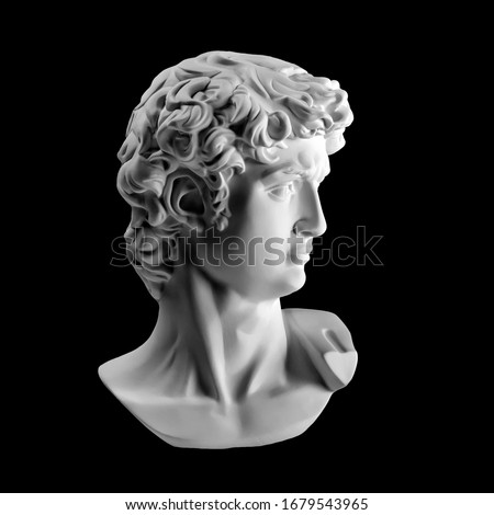 Gypsum statue of David's head. Michelangelo's David statue plaster copy isolated on black background. Ancient greek sculpture, statue of hero #1679543965