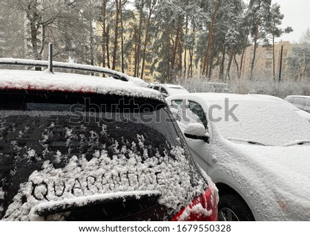 quarantine. Inscription text on a car that stands in the snow in the parking lot. Transport during the pandemic.