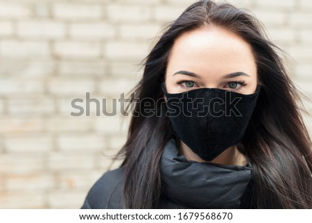 Lady with a black respirator mask. #1679568670
