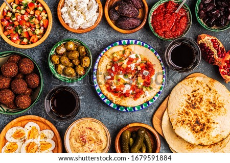Traditional dishes of Israeli and Middle Eastern cuisine -malavach with different fillings, top view. #1679591884