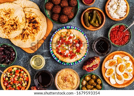Traditional dishes of Israeli and Middle Eastern cuisine -malavach with different fillings, top view. #1679593354