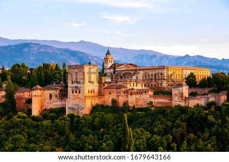 Granada, Spain. Aerial view of Alhambra Palace in Granada, Spain with Sierra Nevada mountains at the background. Sunset sky #1679643166