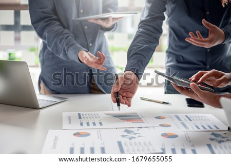Group of business people brainstorming, analyzing and planning to work together at the meeting. Royalty-Free Stock Photo #1679655055