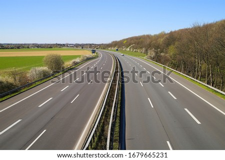 Corona virus crisis stay at home and curfew shutdown concept: no traffic on deserted empty german highway A61 between Germany and Netherlands to border crossing #1679665231