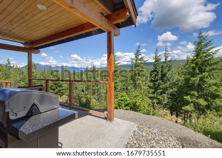 Amazing balcony patio with fire pit and forest and mountains view. Dream come true home exterior. New American architecture. Comfortable and beautiful home details. #1679735551